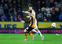 Ki Sung-Yueng of Swansea City and Andrew Robertson of Hull City during the Capital One Cup match between Hull City and Swansea City played at the Kingston Communications Stadium, Hull