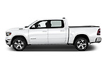 Car driver side profile view of a 2019 Ram 1500 Crew Cab Laramie Short Box 4x2 4 Door Pick Up