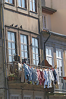 house facade with laundry porto portugal