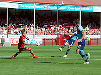 Garry Thompson of Wycombe Wanderers has a shot during the Sky Bet League 2 match between Crawley Town and Wycombe Wanderers at Broadfield Stadium, Crawley, England on 6 August 2016. Photo by Alan  Stanford / PRiME Media Images.