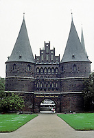 Lubeck: Holsten Gate or Holstentor, 1477. A city gate marking western boundary of Lubeck.  Note the stepped gable motif. Brick Gothic construction.  Photo '87.
