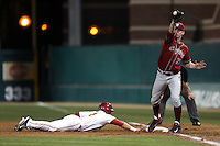 Tyler McDowell (22) of the Washington State Cougars catches a throw  as Jeremy Martinez (2) of the Southern California Trojans slides back to first base during a game at Dedeaux Field on March 13, 2015 in Los Angeles, California. Southern California defeated Washington State, 10-3. (Larry Goren/Four Seam Images)