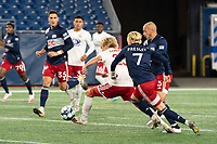 FOXBOROUGH, MA - OCTOBER 16: Thomas Roberts #23 of North Texas SC under pressure from Connor Presley #7 of New England Revolution II and Tiago Mendonca #33 of New England Revolution II during a game between North Texas SC and New England Revolution II at Gillette Stadium on October 16, 2020 in Foxborough, Massachusetts.