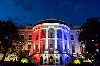 The South Portico of the White House is seen lit up in red, white and blue lights during the Fourth of July Celebration, Sunday, July 4, 2021, as President Joe Biden, First Lady Jill Biden and members of their family watch fireworks from the Blue Room Balcony. (Official White House Photo by Erin Scott)