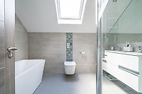 BNPS.co.uk (01202 558833)<br /> Pic: ShorePartnership/BNPS<br /> <br /> Pictured: A bathroom.<br /> <br /> A brand new waterfront home perfect for paddleboarders is on the market for £1.3m.<br /> <br /> Creek View is built on a former boatyard and has direct water access to Restronguet Creek from steps in the back garden.<br /> <br /> The contemporary four-bedroom house has an open-plan living space and floor-to-ceiling glass overlooking the water to make the most of its stunning location.
