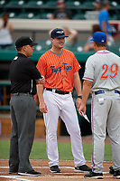 Lakeland Flying Tigers manager Andrew Graham (17) meets with St. Lucie Mets manager Chad Kreuter (29) and an umpire before the second game of a doubleheader against the St. Lucie Mets on June 10, 2017 at Joker Marchant Stadium in Lakeland, Florida.  Lakeland defeated St. Lucie 9-1.  (Mike Janes/Four Seam Images)