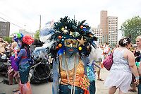 People dress up as mermaids and other sea creatures during Coney Island's 2011 Mermaid Parade, a celebration of the sand, the sea, the salt air, and the beginning of summer, as well as the history and mythology of Coney Island, Coney Island pride, and artistic self-expression, held at Coney Island in Brooklyn, New York, 18 June 2011.