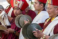 Nepal, Kathmandu, Swayambhunath.  Buddhist Monks Playing Cymbals during a Ceremony.