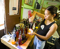 Young woman making Matsumoto's Shave Ice inside their Haleiwa store on Oahu's North Shore, Hawaii