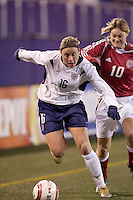 """Abby Wambach of the USA is marked by Denmark's Anne Dot Eggers. The US Women's National Team tied the Denmark Women's National Team 1 to 1 during game 8 of the 10 game the """"Fan Celebration Tour"""" at Giant's Stadium, East Rutherford, NJ, on Wednesday, November 3, 2004.."""