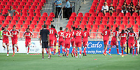 18 July 2012: The entire Toronto FC team takes warm-up during an MLS game between the Colorado Rapids and Toronto FC at BMO Field in Toronto, Ontario..Toronto FC won 2-1..