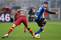 Gianluca Mancini of AS Roma and Nicolo Barella of FC Internazionale compete for the ball during the Serie A football match between AS Roma and FC Internazionale at Olimpico stadium in Roma (Italy), January 10th, 2021. Photo Andrea Staccioli / Insidefoto