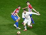 Atletico de Madrid's Koke Resurrecccion (l) and Saul Niguez (r) and Real Madrid's Mateo Kovacic during La Liga match. November 19,2016. (ALTERPHOTOS/Acero)