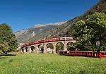 Schweiz, Graubuenden, Brusio im Puschlavtal (Val Poschiavo), der Bernina-Express faehrt hier zwecks Hoehengewinnung ueber das bekannte Kreisviadukt | Switzerland, Graubuenden, Brusio at Val Poschiavo with Bernina Express at the spiral viaduct