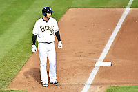 Brennan Boesch (23) of the Salt Lake Bees takes his lead off of third base against the Fresno Grizzlies at Smith's Ballpark on April 9, 2014 in Salt Lake City, Utah.  (Stephen Smith/Four Seam Images)