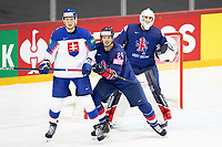 23rd May 2021, Riga Olympic Sports Centre Latvia; 2021 IIHF Ice hockey, Eishockey World Championship, Great Britain versus Slovakia;  24 Joshua Tetlow Great Britain and 8 Pavol Skalicky Slovakia grappling in the slot in front of goalkeeper Ben Bowns Great Britain