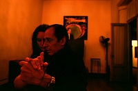 """Maestro Víctor, """"el Cacha"""", Pruno guides one of his students through the dancing room of the National Academy of Tango in Buenos Aires, May 2003."""