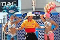 Apr. 13, 2008; Las Vegas, NV, USA: NHRA top fuel dragster driver David Grubnic jokes with showgirls prior to the SummitRacing.com Nationals at The Strip in Las Vegas. Mandatory Credit: Mark J. Rebilas-