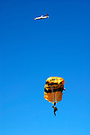 An Army stunt parachutist prepares for a landing after jumping out of the airpland as part of pre-game festivities before the annual Notre Dame/USC football game in October 19, 2003.