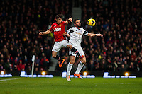 Saturday 11 January 2014 Pictured: Shinji Kagawa  of Manchester United and Jordi Amat jump for the ball<br /> Re: Barclays Premier League Manchester Utd v Swansea City FC  at Old Trafford, Manchester