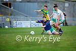 Ballydonoghue keeper Darrah O'Shea challenged for possession by Jack Cremin of Gneeveguilla in the 2020 County Junior Premier football final