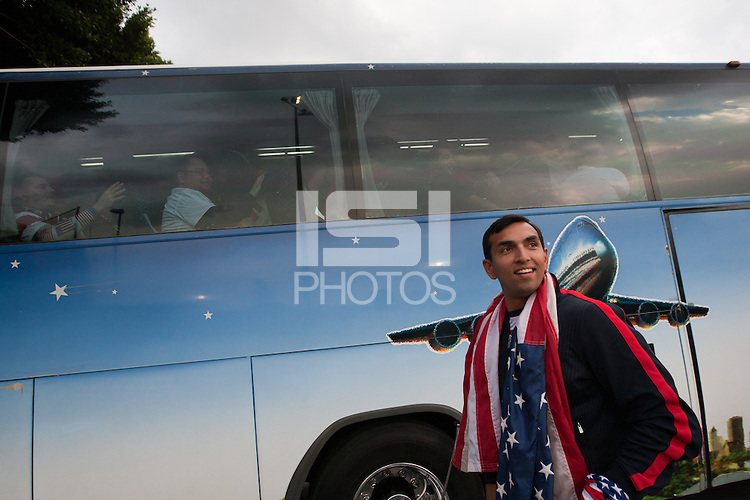 USA fan Rishi Segal takes in Mexican police officers in riot gear forming a perimeter around a bus of USA fans arriving for the USA vs. Mexico World Cup Qualifier at Azteca stadium in Mexico City, Mexico on March 26, 2013.