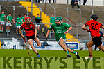 Kieran O'Carroll, Ballyduff, in action against David O'Sullivan, Ballyheigue, during the Kerry County Minor Hurling Championship Final match between Ballyduff and Ballyheigue at Austin Stack Park in Tralee, Kerry.