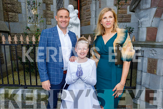 Sophie Buckley from Moyderwell NS receiving her First Holy Communion on Saturday in St Johns Church, standing with her parents David and Marie Buckley.