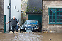"""15/01/19<br /> <br /> Ian Busting surveys the damage to his home and his wife's florist business. He said: """"My wife is devastated. Everything's ruined. Someone will have to pay for all this. We have a large corporate order which needs to go out on Thursday. We'll have to find a way of completing the order.""""<br /> <br /> A giant spout of water fires into the sky as high as a tall tree after locals say a farmer burst a water main while putting in a fence post this morning. The torrent of water near Shaws Lane, has caused flooding in the nearby village of Milford, Derbyshire. <br /> <br /> <br /> All Rights Reserved, F Stop Press Ltd.  (0)7765 242650  www.fstoppress.com rod@fstoppress.com"""
