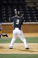 Ben Breazeale (9) of the Wake Forest Demon Deacons at bat against the Delaware Blue Hens at Wake Forest Baseball Park on February 13, 2015 in Winston-Salem, North Carolina.  The Demon Deacons defeated the Blue Hens 3-2.  (Brian Westerholt/Four Seam Images)
