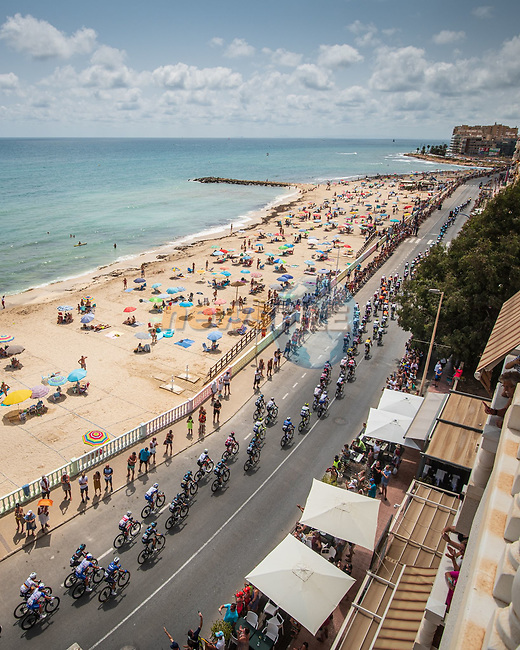 The peloton pass Playa de Torrevieja during Stage 8 of La Vuelta d'Espana 2021, running 173.7km from Santa Pola to La Manga del Mar Menor, Spain. 21st August 2021.     <br /> Picture: Charly Lopez/Unipublic | Cyclefile<br /> <br /> All photos usage must carry mandatory copyright credit (© Cyclefile | Unipublic/Charly Lopez)