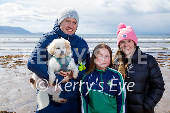 Enjoying a stroll on Inch beach on Saturday, l to r: Evan Horan, Holly McLoughlin and Caoimhe Nugent with Alfie the dog.