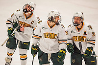 20 January 2017: University of Vermont Catamounts Mario Puskarich (left) Mike Lee (center) and Chris Muscoby (right) celebrate a third period goal against the University of Connecticut Huskies at Gutterson Fieldhouse in Burlington, Vermont. The Catamounts lead throughout the game to defeat the Huskies 5-4 in Hockey East play. Mandatory Credit: Ed Wolfstein Photo *** RAW (NEF) Image File Available ***