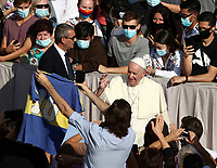 Pope Francis greets faithful as he arrives to hold a limited public audience at the San Damaso courtyard in The Vatican on September 9, 2020 during the COVID-19 infection, caused by the novel coronavirus.<br /> UPDATE IMAGES PRESS/Isabella Bonotto<br /> <br /> <br /> STRICTLY ONLY FOR EDITORIAL USE