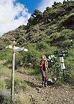 Spain, Canary Islands, La Palma, near Los Llanos de Aridane: Barranco de las Angustias - woman hiking towards Caldera de Taburiente