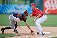Buffalo Bisons first baseman Jordan Patterson (15) waits for a pickoff attempt throw as Eric Wood (14) gets back to the bag during an International League game against the Indianapolis Indians on June 20, 2019 at Sahlen Field in Buffalo, New York.  Buffalo defeated Indianapolis 11-8  (Mike Janes/Four Seam Images)