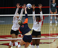 Auburn Junior Rebekah Rath (7) spikes the ball as Maggie Cartwright (11) and Abigail Archibong (9) of Arkansas go up for block on Sunday, Oct. 10, 2021, during play at Barnhill Arena, Fayetteville. Visit nwaonline.com/211011Daily/ for today's photo gallery.<br /> (Special to the NWA Democrat-Gazette/David Beach)