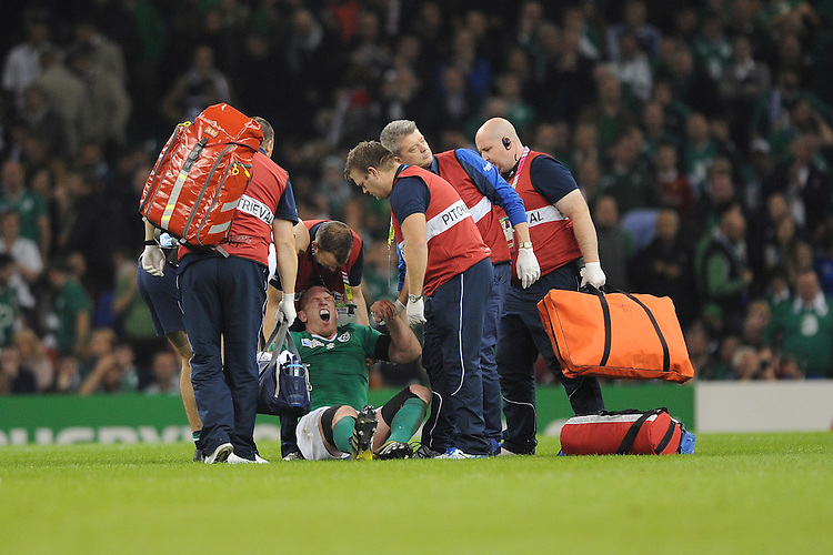 Paul O'Connell of Ireland tries to stand after sustaining an injury but is stretchered off shortly after during Match 39 of the Rugby World Cup 2015 between France and Ireland - 11/10/2015 - Millennium Stadium, Cardiff<br /> Mandatory Credit: Rob Munro/Stewart Communications