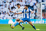 Raphael Varane (L) of Real Madrid fights for the ball with Florin Andone of RC Deportivo La Coruna during the La Liga 2017-18 match between Real Madrid and RC Deportivo La Coruna at Santiago Bernabeu Stadium on January 21 2018 in Madrid, Spain. Photo by Diego Gonzalez / Power Sport Images