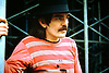 """Don Van Vliet, born Don Glen Vliet; January 15, 1941 – December 17, 2010) was an American singer, songwriter, musician and artist best known by the stage name Captain Beefheart. His musical work was conducted with a rotating ensemble of musicians called the Magic Band (1965–1982), with whom he recorded 13 studio albums. Noted for his powerful singing voice and his wide vocal range, Van Vliet also played the harmonica, saxophone and numerous other wind instruments. His music integrated blues, rock, psychedelia, and jazz with contemporary experimental composition and the avant-garde; many of his works have been classified as """"art rock."""" Beefheart was also known for often constructing myths about his life and for exercising an almost dictatorial control over his supporting musicians.<br /> <br /> An artistic prodigy in his childhood, Van Vliet later developed an eclectic musical taste during his teen years in Lancaster, California, and formed """"a mutually useful but volatile"""" friendship with musician Frank Zappa, with whom he sporadically competed and collaborated.<br /> <br /> This photo was taken at The Knebworth Festival, Hertfordshire, England in 1974.<br /> <br /> Here is a link to a recording of the set:<br /> https://www.youtube.com/watch?v=qmOiNnUVK-g&list=RDqmOiNnUVK-g#t=34<br /> <br /> Stock Photo by Paddy Bergin"""