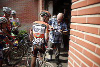 during the 2nd neutralisation of the race the thirsty riders seek drinks at the surrounding houses<br /> <br /> 90th Schaal Sels 2015