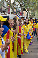 Line of people with Catalan flags on Barcelona at National Day of Catalonia, Spain