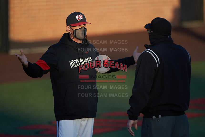 Western Kentucky Hilltoppers head coach John Pawlowski argues a call with first base umpire Eric Dunsford during the game against the Valparaiso Crusaders at Nick Denes Field on March 19, 2021 in Bowling Green, Kentucky. (Brian Westerholt/Four Seam Images)