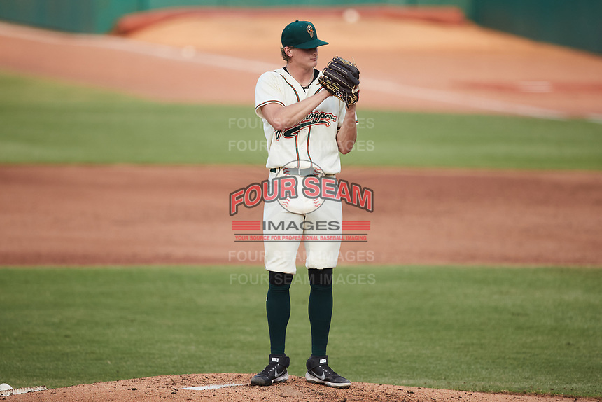Greensboro Grasshoppers starting pitcher Quinn Priester (15) looks to his catcher for the sign against the Wilmington Blue Rocks at First National Bank Field on May 25, 2021 in Greensboro, North Carolina. (Brian Westerholt/Four Seam Images)