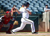 Phoenix Desert Dogs first baseman Hunter Morris #9, of the Milwaukee Brewers organization, during an Arizona Fall League game against the Peoria Javelinas at Phoenix Municipal Stadium on October 12, 2012 in Phoenix, Arizona.  Phoenix defeated Peoria 13-3.  (Mike Janes/Four Seam Images)