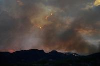 Aug. 14, 2012; Desert mountain sunset sky fire cloud wildfire smoke Mandatory Credit: Mark J. Rebilas