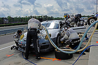#44 Magnus Racing Porsche GT3 of Andy Lally & John Potter makes a  pit stop and driver change.  class: Grand Touring (GT)