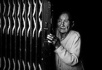 """This beautiful old lady just open the gate for me. Near Can Tho, the hub of the Mekong Delta (Vietnamese: Đồng bằng Sông Cửu Long """"Nine Dragon river delta""""), also known as the Western Region (Vietnamese: Miền Tây or the This beautiful old lady just open the gate for me. Near Can Tho, the hub of the Mekong Delta (Vietnamese: Đồng bằng Sông Cửu Long """"Nine Dragon river delta""""), also known as the Western Region (Vietnamese: Miền Tây or the South-western region (Vietnamese: Tây Nam Bộ) is the region in southwestern Vietnam where the Mekong River approaches and empties into the sea through a network of distributaries. The Mekong delta region encompasses a large portion of southwestern Vietnam of 39,000 square kilometres (15,000 sq mi). The size of the area covered by water depends on the season.<br /> The Mekong Delta has been dubbed as a """"biological treasure trove"""". Over 1,000 animal species were recorded between 1997 and 2007 and new species of plants, fish, lizards, and mammals has been discovered in previously unexplored areas, including the Laotian rock rat, thought to be extinct."""