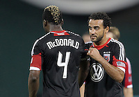 WASHINGTON, DC. - AUGUST 22, 2012:  Dwayne DeRosario (7) of DC United gives the captain's arm band to Brandon McDonald (4) as he is subbed out against the Chicago Fire during an MLS match at RFK Stadium, in Washington DC,  on August 22. United won 4-2.
