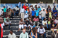 The bleachers empty as punters make thier way to collect winnings and place bets after a race finished at Ngong Racecourse in Nirobi, Kenya. Brendan Bannon. April 14, 2013